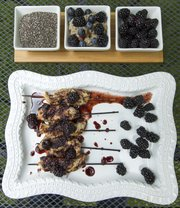 Vanilla Chia Pudding with Blackberries and Blueberries, pictured at top, and Chicken Satay with Blackberry-Ginger Sauce utilize this month's Delicious/Nutritious ingredient of blackberries in different ways.