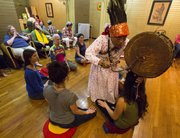"Shaman Ngema ""Maile"" Lama makes her away around the room clearing and offering protection to those present during a Chinta ceremony at Elevate Ascension, 1407 Massachusetts St. Maile, a shaman who practices an ancient form of spiritual healing with roots in the pre-Buddhist Bon tradition of Tibet, performed the ceremony to clear and protect the space and those who were present."