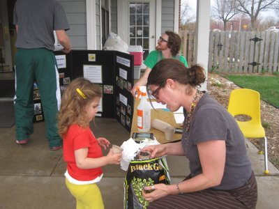 Planting seeds at a CSA info booth