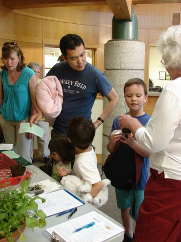 Families checking out the Master Gardeners' booth