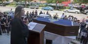 The Rev. Josh Longbottom leads a memorial service for the state of Kansas on Saturday. The event, including a funeral procession down Massachusetts Street, was a protest to Gov. Sam Brownback's tax policies.