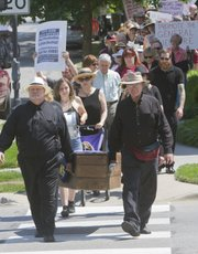Pallbearers carry Kansas' casket from Plymouth Congregational Church to South Park on Saturday.