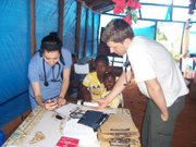 Lawrence nursing students Sarah Bradshaw and Elijah Penny do intake at a makeshift medical clinic in Haiti last month.