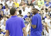 Kansas forward Jamari Traylor smiles with coach Bill Self as he talks with a gathering of young basketball campers during Self's basketball camp, Monday, June 10, 2013 at the Horejsi Center.