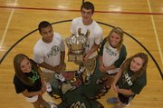 Class of 2013 Free State High athletes Kennedy Kirkpatrick, Demarko Bobo, Kyle McFarland, Chelsea Casady and Courtney Parker pose with the World Company Cup, awarded annually to the school which prevails most often in the City Showdowns between rivals Lawrence High and Free State. The Firebirds won the cup, 17-9, in the 2012-13 school year.