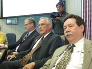 State Board of Education member Ken Willard (center), a Hutchinson Republican, voted against the Next Generation Science Standards, arguing they are not religiously neutral because of the way they treat evolution. Board member John Bacon (left), an Olathe Republican, also voted no. Steve Roberts (right), an Overland Park Republican, voted in favor of the standards, although he had reservations because they were written largely by professors from schools of education.