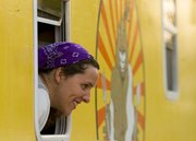 England Porter, Lawrence, one of the co-owners of the Blissful Bite food truck, talks to customers during the annual Relay for Life event, held Friday, June 7, 2013, at Free State High School.