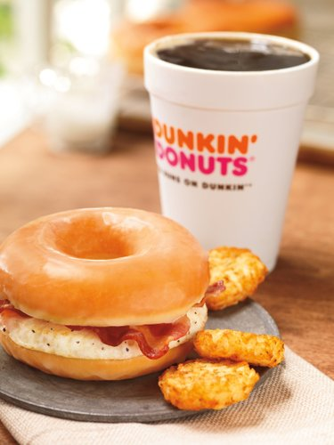 Even as fast-food chains tout their healthy offerings, they're also coming up with fatty new treats to keep customers interested. Case in point: Dunkin' Donuts is adding a doughnut breakfast sandwich to its national menu beginning June 2013. (AP Photo/Dunkin' Brands, Inc., James Scherer)
