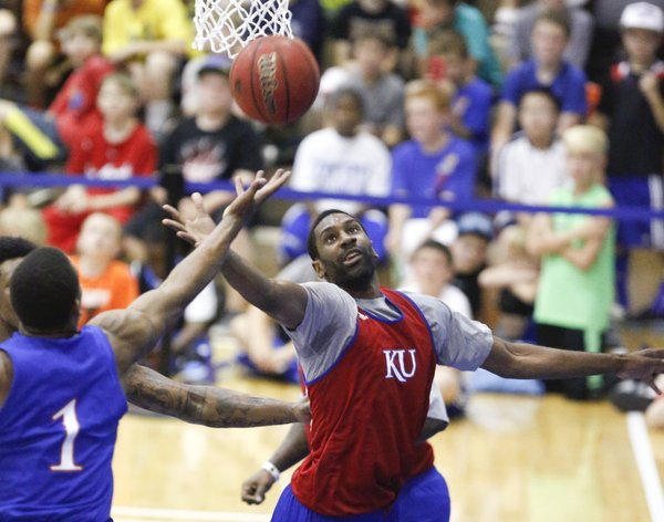 Red team forward Justin Wesley fights for a rebound with Blue team guard Wayne Selden during a scrimmage on Wednesday, June 12, 2013 at the Horejsi Center.