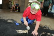 A young scientist uncovers more evidence that dinosaurs existed at DigSite in the DinoLab in Science City.