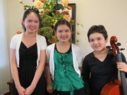 From left, Chaeyoung Park, piano; Emily Shehi, violin; Dana Rath, cello, make up Trio Aër, a Lawrence based group of young musicians who recently won Grand Prize in the 2013 National Young Artists Chamber Music and Ensemble Competition. Today they will give a performance at Merkin Concert Hall in Kaufman Music Center in New York.