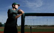Free State High School assistant baseball coach Nolan Deitrich is pictured on Thursday, June 13, 2013 in the dugout at the baseball field. Throughout this last season, the Firebirds sought inspiration from Deitrich's daughter Lila, who in March died of respiratory syncytial virus.
