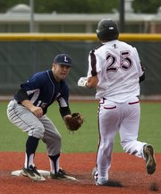 Lawrence Raiders' Shane Willoughby, left, waits on second base to tag out Natural Baseball Academy's Clinton Blankenship (25) during the first game of their doubleheader, Saturday, June 15, 2013, at Lawrence High.