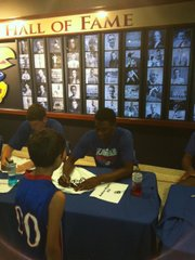 Kansas freshman Andrew Wiggins signs an autograph at the Bill Self basketball camp on Sunday, June 16, 2013, at the Booth Family Hall of Athletics.