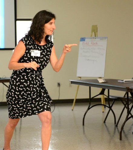 Elizabeth Ablah asks a question during a recent workshop on workplace wellness at K-State Research and Extension — Douglas County. About 20 Lawrence employees attended the training. Uploaded