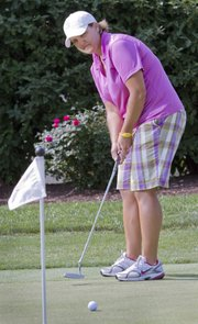 Kristen Samp, a teaching professional at Lawrence Country Club, along with KU finance professor Catherine Shenoy and three others, will play 100 holes of golf at LCC Monday, June 24, as part of a nationwide event - the 100 Hole Hike. Samp made practice putts at LCC on Thursday.