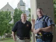 Long-time officers with the Douglas County Sheriff's Office, lieutenants Steve Grammer, left, and Gary Squires retired Friday. Grammer spent 22 years with the department, and Squires 32.