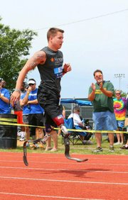 Colby Liston competes earlier this month in the 14th annual Endeavor Games at the University of Central Oklahoma. Liston was pinned between two cars in August 2012 while attending Kansas University. His legs were severed just above the knee and he now wears prosthetic limbs.