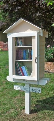 "Derrick Abromeit&squot;s ""Little Free Library"" sits on his lawn, encouraging neighbors to read."