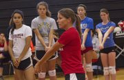LHS volleyball coach Stephanie Magnuson works with campers at the LHS volleyball camp on Monday, June 24, 2013, at LHS.