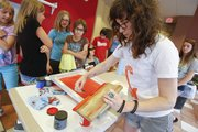 Lawrence artist Leslie Kuluva prepares her screenprinting materials during a workshop for teens, Friday, June 21, 2013, at the Lawrence Public Library.