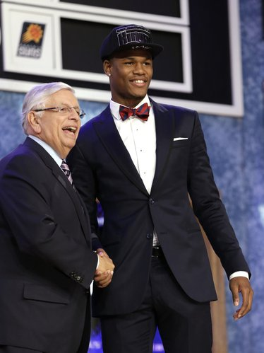 NBA Commissioner David Stern, left, shakes hands with Kansas' Ben McLemore, who was selected by the Sacramento Kings in the first round of the NBA basketball draft, Thursday, June 27, 2013, in New York.