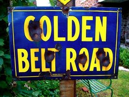 Antique 'Golden Belt Road' sign.