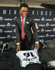 Sacramento first-round draft pick Ben McLemore picks up his jersey after a news conference Monday, July 1, 2013, in Sacramento, Calif.