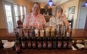 Mark and Pam Thomeczek of Marshall, Mo., sample wine in the tasting room at BlueJacket Crossing Vineyard and Winery outside Eudora. BlueJacket Crossing, a designated Kansas agritourism site, sells more wine by being able to offer a farm experience to go with it, owner Pep Selvan-Solberg says.