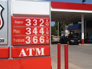 Gasoline prices dipped below $3.33 this week in Lawrence, lower than they had been in months. Travelers are also likely to find lower prices elsewhere in the country, as the national average price of gas has declined for three weeks this summer.