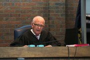 Franklin County District Judge Thomas H. Sachse hears the case of Kyle T. Flack, 27, of Ottawa, charged in May with the killings of three adults and one 18-month-old child. On Monday, Sachse refused to issue a blanket order sealing all documents in the case, and scheduled a pretrial process that will continue for at least seven months. Bobby Burch/The Ottawa Herald