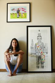 "American Indian artist Jodi Webster believes it is important for an artist to have the ability to work in multiple mediums. Above is a screenprint titled ""I&squot;m Not That Kind of Indian."" At right is a drawing titled ""Wabansi: Lakeside Chicago-Beyond Swag."" Webster is pictured Tuesday, July 9, 2013, in her Lawrence home."