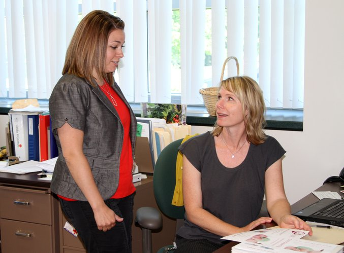 Jolene Croxell, left, WIC supervisor, visits with Cary Allen, breast-feeding peer counselor, about the Douglas County breast-feeding support group. Croxell joined the Health Department staff in June.