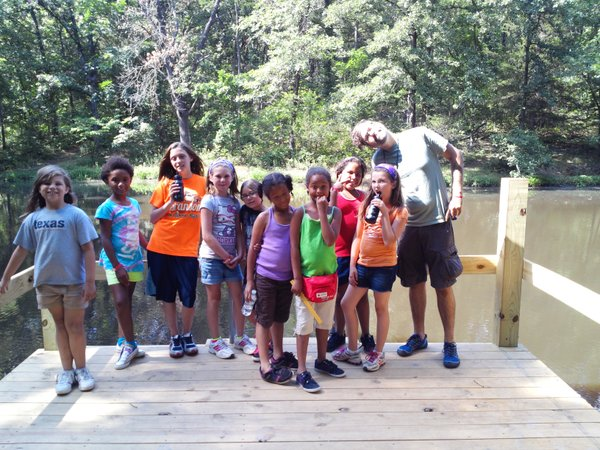 Youth and staff taking a break from hiking and exploring trails.