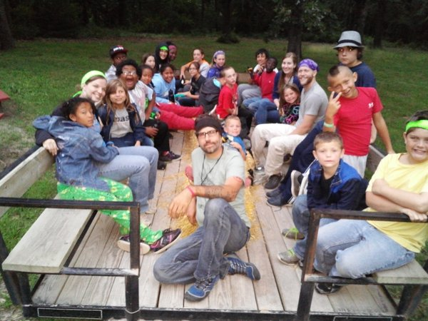 Youth and staff on a hayride to the bonfire site.