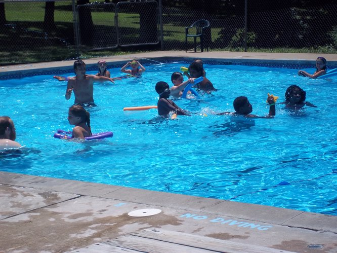 Youth enjoying an afternoon of swimming at the Tall Oaks pool.