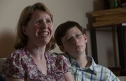 Stacy Tucker, 35, and her 11-year-old son, Michael, both have learning disabilities. The Lawrence woman has become an advocate for people with similar disabilities.