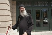 Lawrence resident Michael Wilson 55, has been the janitor at Liberty Hall for more than two decades but has a second job, as the deacon for a Serbian Orthodox church in Kansas City, Mo.