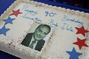 The Dole Institute of Politics at Kansas University celebrated Bob Dole's 90th birthday on Monday with cake and kid-friendly activities.