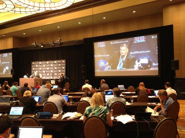 Charlie Weis at podium.