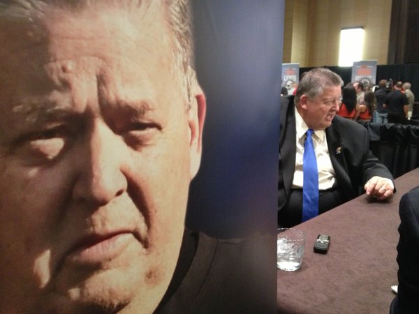 Charlie Weis talks to reporters on Monday afternoon at media days.