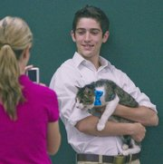 Mason Kelso, 17, along with his cat, Indiana Jones, were at the Douglas County Fair Grounds as 4-H club members showed off their pets to judges on Saturday July 20, 2013.