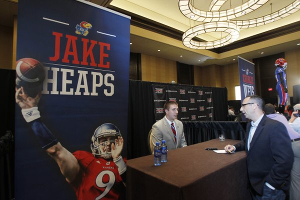 Kanas quarterback Jake Heaps conducts interviews during a breakout session at the Big 12 conference football media days on Monday, July 22, 2013 in Dallas.