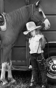 Julie Carden, age 6, is shown with her pony, Princess, in 1988.