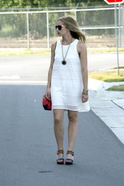 Elizabeth Kennedy wears a white, lightweight cotton dress from Urban Outfitters that's perfect for summer.