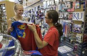 Haley Domin, left, and Mattie DeSimone check out KU Jayhawk clothes Saturday, July 27, at Jayhawk Spirit, at 935 Massachusetts St. The two girls, who are seniors in high school in Chicago, were visiting KU last week as prospective students.