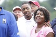 Mario Chalmers, center, and his mom, Almarie, wait the start of Mario's benefit golf tournament on Monday, July 29, 2013, at Alvamar.