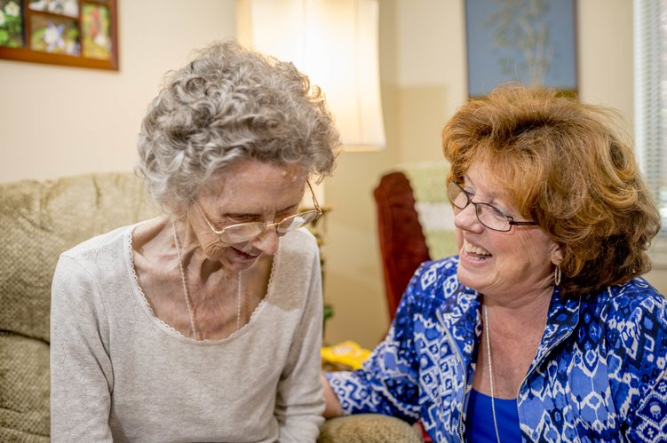 Ginger Hayes visits with a patient after a routine home care visit.  Photo by Earl Richardson