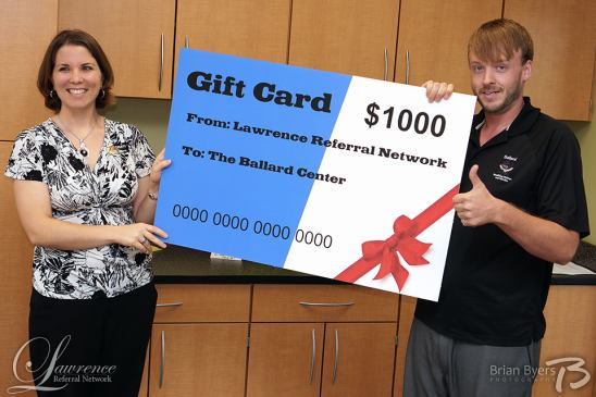 LRN President, Allison Gowing presents a gift card to Kyle Roggenkamp from Ballard Center& Penn House.  Photo by Brian Byers