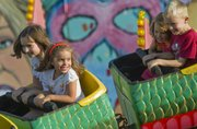 In the forward car, Kaleigh Griffith, 8, left, and her sister Shea, 4, Baldwin City, ride a roller coaster at the Douglas County Fair. To capture the speeding subjects, I pre-focused on a spot on the roller-coaster tracks then locked in my focus. As the cars passed through that area, I could take my photograph knowing my focus point remained locked.